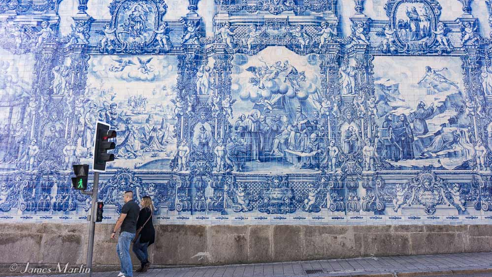 Blue Tiles Called Azulejos On The Exterior Of The Church Of Saint Ildefonso